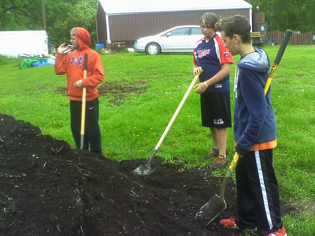 Hard at work filling our new accessible raised beds at the garden site